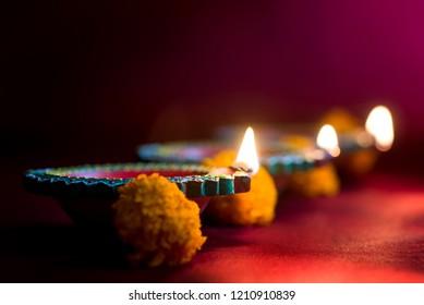 Happy Diwali - Diya lamps lit during Diwali celebration. Greetings Card Design of Indian Hindu Light Festival called Diwali