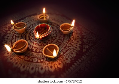 Happy Diwali - Diya lamps lit during diwali celebration