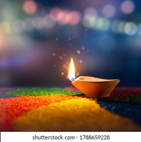 Happy Diwali, Lit diya lamp on an abtract background with shallow depth of field