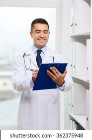 happy doctor with clipboard in medical office