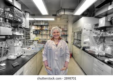Happy Doctor  -  female worker in lab of biology  industry