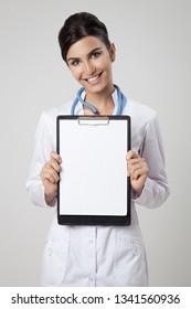 Happy doctor holding empty blank in hands