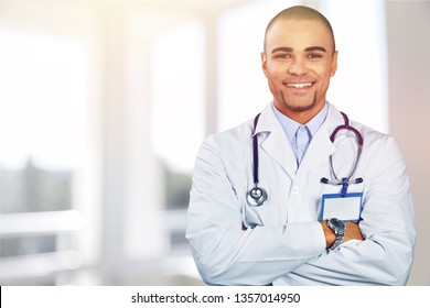 Happy doctor on background