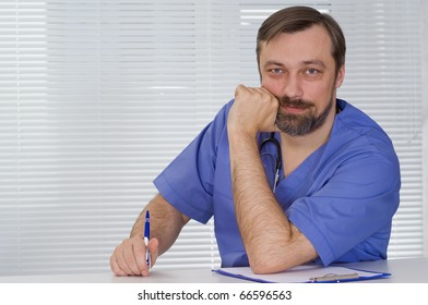 happy doctor sitting on the white background