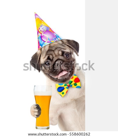 Happy Dog In Birthday Hat With Tie Bow Holding Light Beer And Peeking Above White Banner