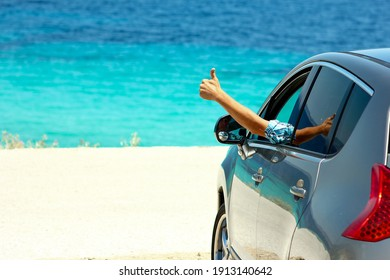 happy driver man in car at sea in summer