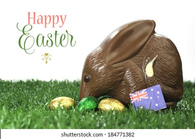 Happy Easter Australian style chocolate easter egg bunny Bilby on grass and white background with sample text or copy space for your text here.