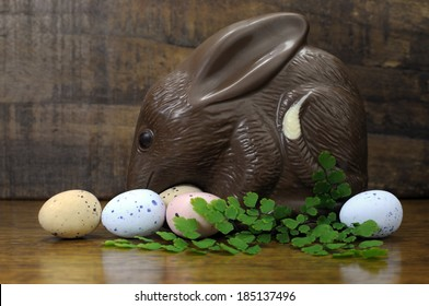 Happy Easter Australian style chocolate easter egg bunny Bilby against retro vintage dark wood rustic country style background.