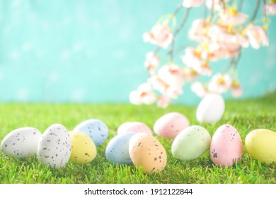 Happy Easter background, spring-time concept. Colorful pastel eggs, nests and bunny toys on  sunny spring day, meadow green grass.  - Shutterstock ID 1912122844