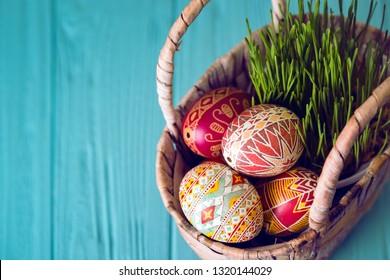 Happy Easter - basket with beautiful Easter egg Pysanka handmade. ukrainian traditional