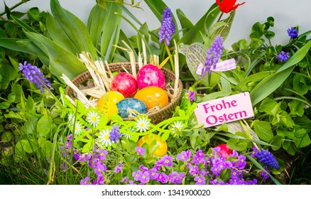 Happy Easter - Easter baskets with eggs in colorful flowers