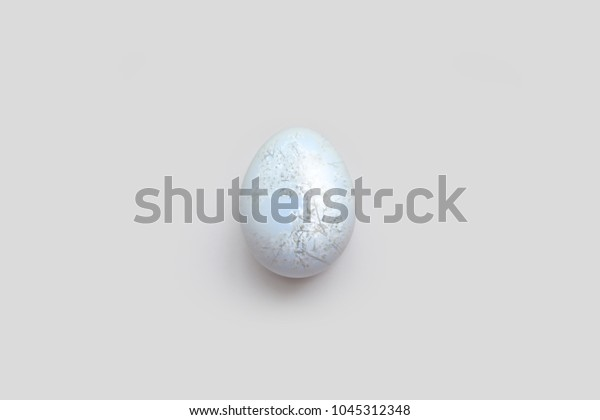 Happy Easter. Beautiful background with one egg and white blossom tree on it.