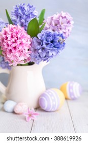 Happy Easter. Bouquet of spring flowers and Easter Eggs. Selective focus.