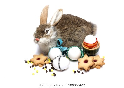 Happy Easter. Bunny Easter Eggs and refreshments to the table. Photo.