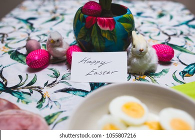 Happy Easter caption on breakfast table with delicious meal and figure
