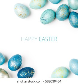 Happy Easter card. Frame  with gold and blue speckled easter eggs with copy space for text. isolated on white background