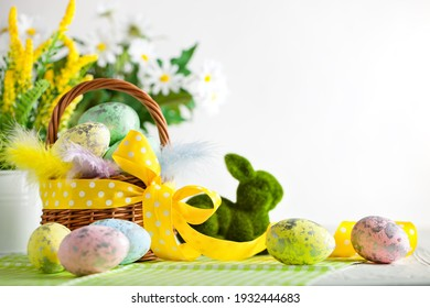 Happy Easter. Congratulatory easter background. Easter eggs and flowers. Background with space for copying. Selective focus.