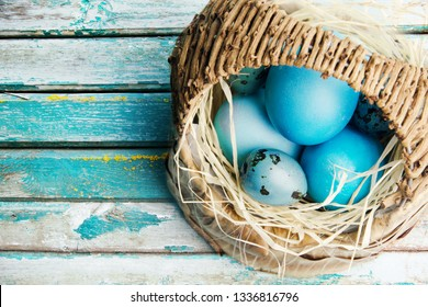 Happy Easter. Congratulatory easter background.Easter eggs in a basket. - Shutterstock ID 1336816796