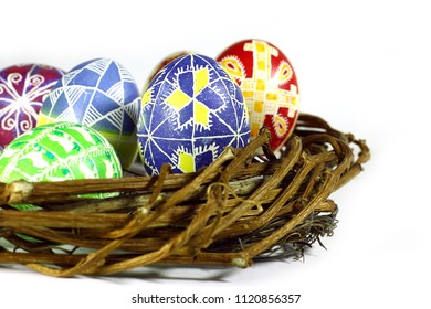 Happy Easter. Congratulatory Easter isolated composition. Handmade eggs in basket.On white background.