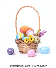Happy Easter day colorful eggs in basket with flowers isolated on white background. - Shutterstock ID 1927647029
