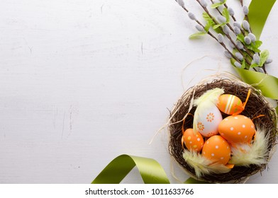 Happy easter decoration background, eggs in the nest, springtime rural composition top view concept