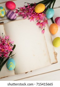 Happy Easter Eggs Card with open book with blank paper pages with room or space for copy, text, wording, all on shabby chic shiplap white board background or table from above looking down view