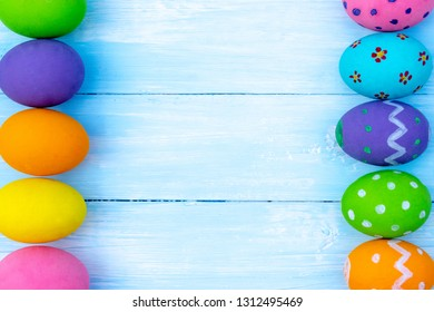 Happy Easter. Easter eggs concept. Row Easter eggs on blue background and copy space for advertisers.