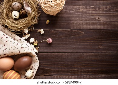 Happy easter. Easter eggs and easter decoration on the wooden table, with copy space.