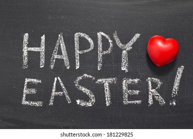 happy easter exclamation phrase handwritten on school blackboard