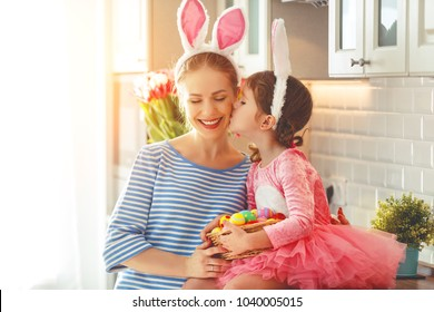 Happy easter! family mother and child daughter with ears hare getting ready for holiday