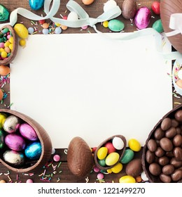 Happy Easter frame with blank space for text,  chocolate eggs,  ribbon bows and candies. Easter concept