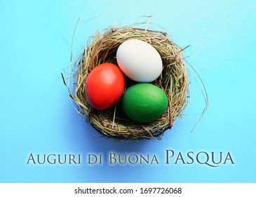 Happy Easter holiday Italian language card, eggs as the color of the Italy flag in nest