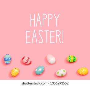 Happy Easter message with Easter eggs on a pink background