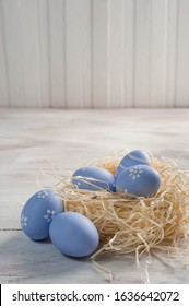 Happy easter painted eggs on wooden colorful table, holiday background for your decoration. Egg hunt, copy space