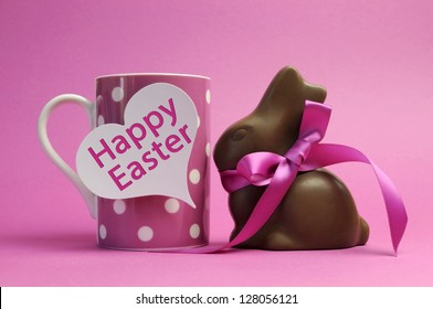 Happy Easter pink polka dot coffee or tea mug with white heart shape gift tag sign and chocolate bunny with pink ribbon, with Happy Easter message.