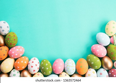 Happy easter! Row Easter eggs on green  pastel background.