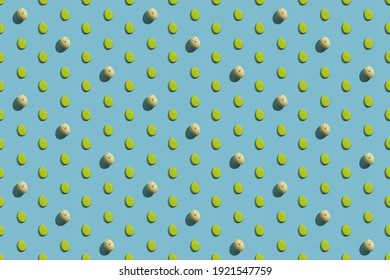 Happy Easter. Seamless background. Colorful holiday decoration. Green yellow painted egg with bunny design minimal diagonal symmetrical cute pattern isolated on blue abstract backdrop.