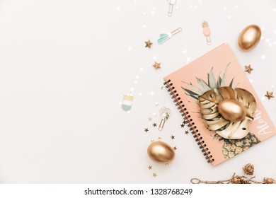 Happy Easter! Stylish stationery background with gold eggs on white background. Table decorating for holiday. Feminine flat lay. Blog easter concept.