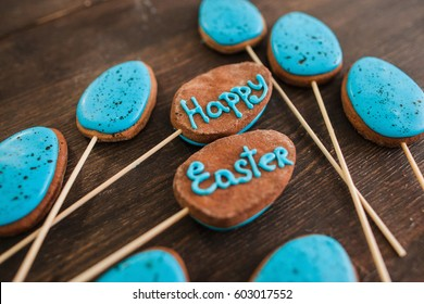 Happy easter sweets and desserts decoration. Blue cake pops with lettering on the wood rustic table for easter celebration, closeup.