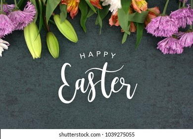 Happy Easter Text With Beautiful Colorful Flowers Bouquet Border Shot From Directly Above Over Black Dark Texture Background, Horizontal