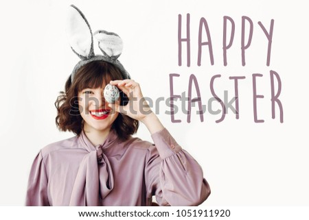Happy easter text seasons greetings card stock photo edit now happy easter text seasons greetings card beautiful happy girl in bunny ears holding colored m4hsunfo