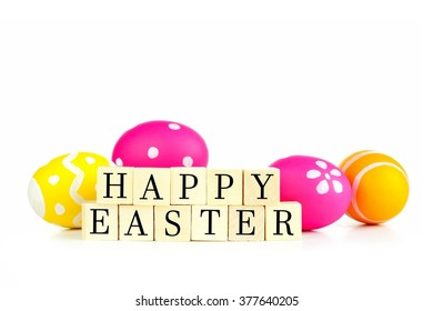 Happy Easter wooden blocks with Easter eggs over a white background
