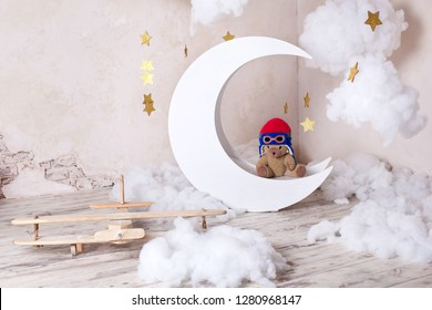 Happy easter! Wooden, vintage decor. A place for a small pilot photo shoot. Hall in a photo studio with an airplane. Little bear on the moon. Bear Pilot. Children's room to play with the child.