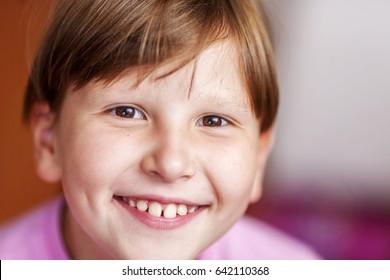 Happy Eight years girl wearing bangs closeup portrait focus on left eye