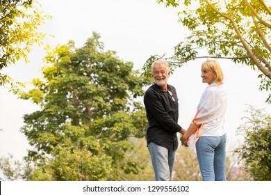 happy elder couple love relaxing in park. Mature Couple Walking