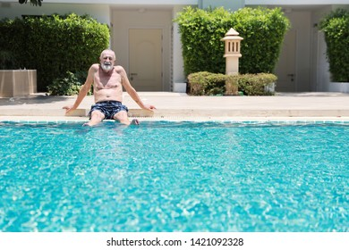happy elderly caucasian take a break while swimming in pool during retirement holiday with relaxation and smiling