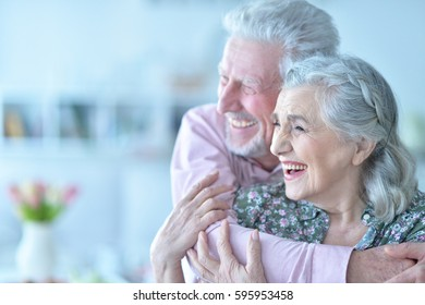 Happy elderly couple embracing