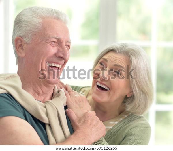 Happy elderly couple embracing