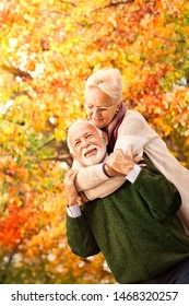 Happy elderly couple in love. Love has been growing for years, senior nice couple in autumn park