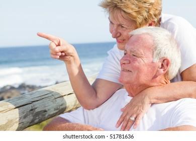 happy elderly couple on beach